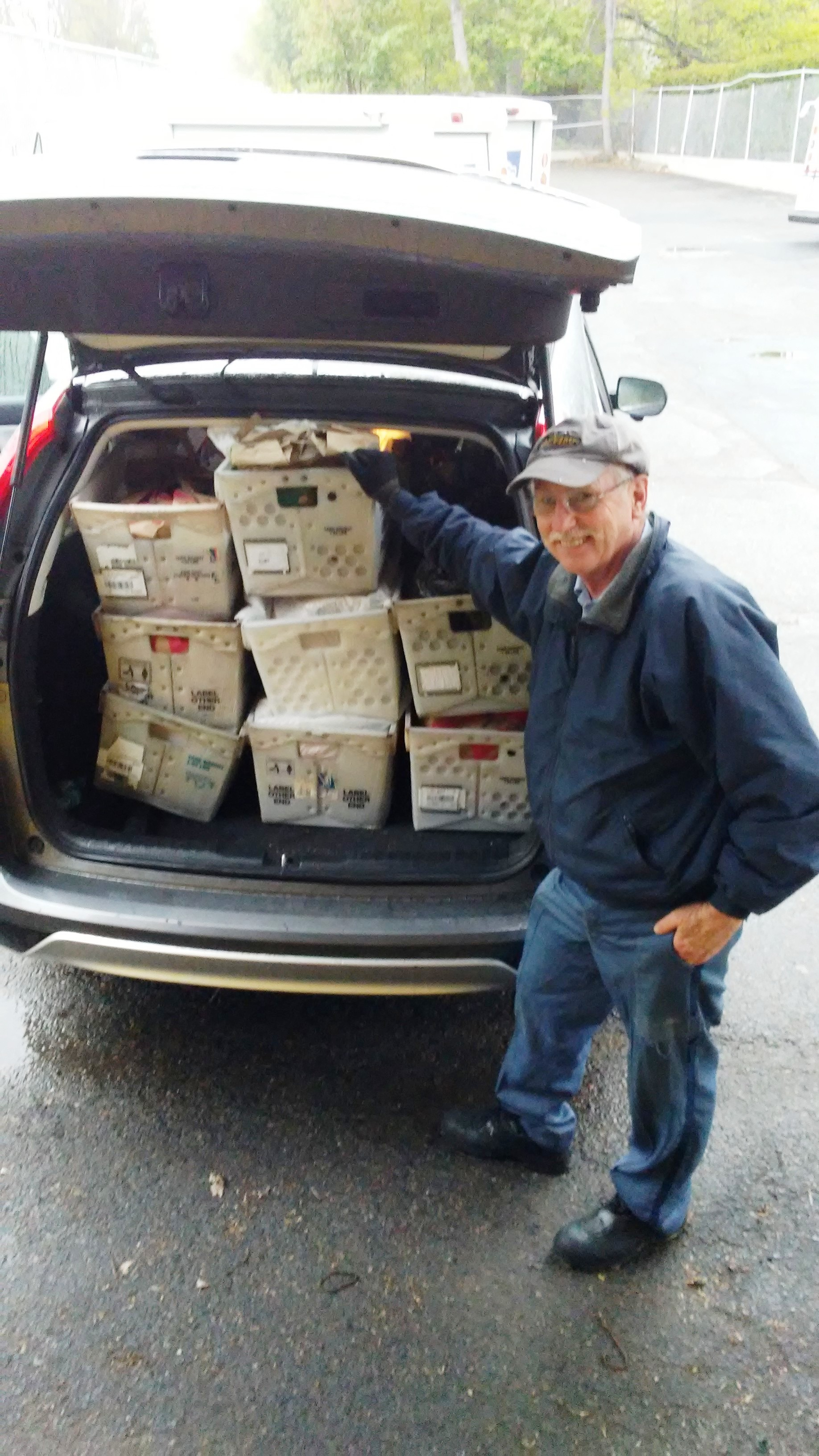 Wellesley Square Steward Mark Lester gets ready to deliver collected food to the local pantry