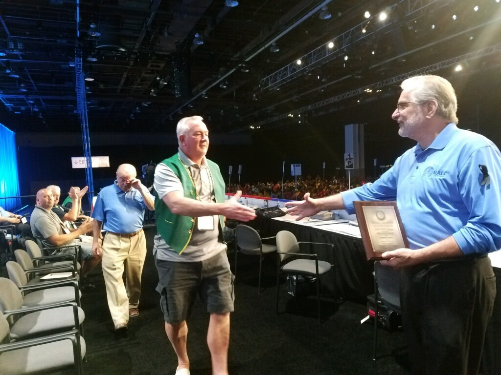 Executive Vice President Kevin Flaherty accepts First Place for his Branch #34 CLAN article on Promoting Unionism.