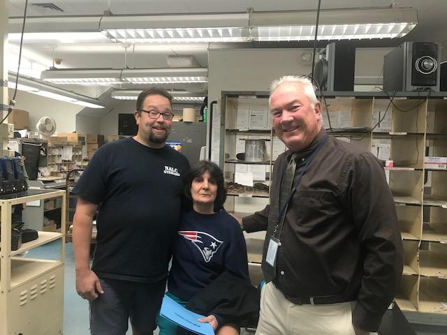 Auburndale's Elaine Saia receives congratulations from Steward Tom Kierstead and Branch Executive VP Kevin Flaherty