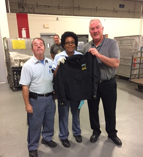 Cambridge Porter Square Steward Bill Crescitelli and Executive Vice President Kevin Flaherty presents Joyce Bazley a Branch #34 Retirement jacket on her last day.