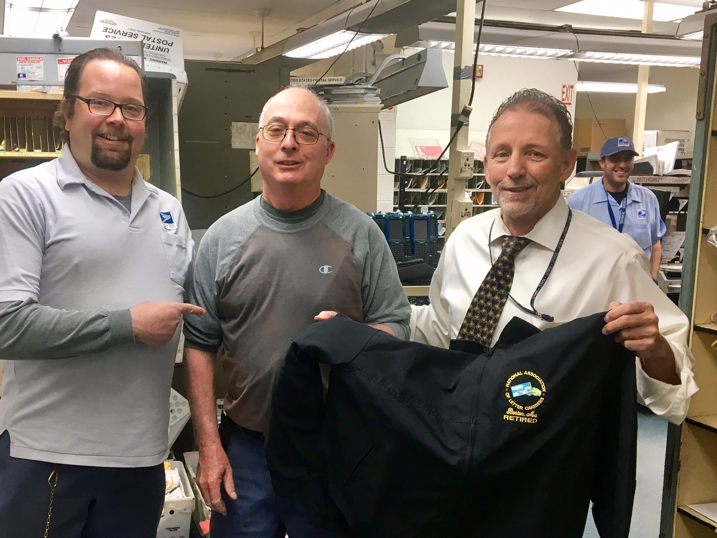 Auburndale Steward Tom Kierstead and President Michael Yerkes congratulate Bob Fadden on his last day following more than 30 years of service