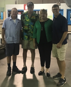 Mark Wentzell is congratulated by Braintree Union Steward, Vice President Bernadette Romans, and Retired Weymouth Letter Carrier Eddie Welch.