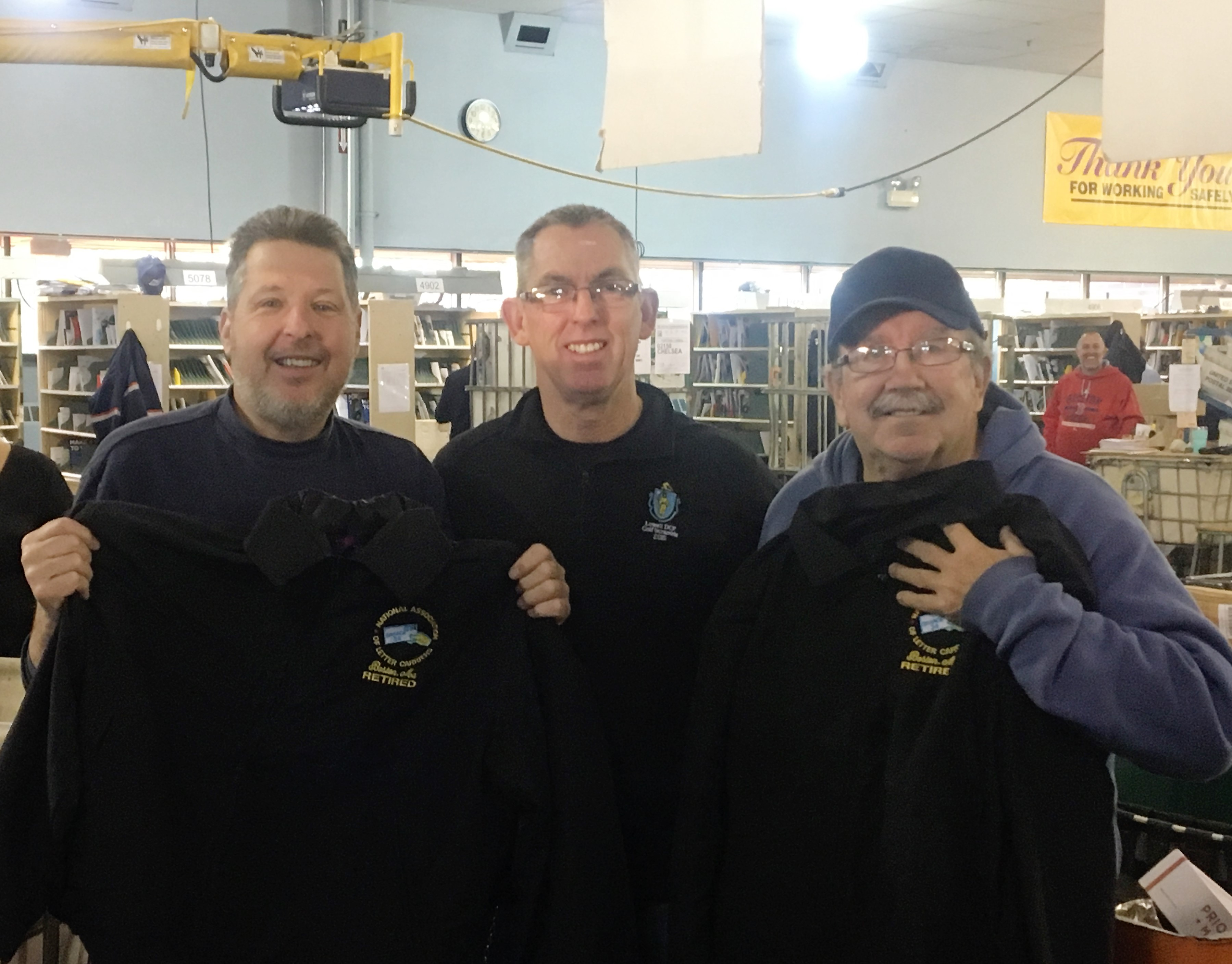 Chelsea Carriers Jim Murphy and Paul McDonald pose with Chelsea Steward Bill Lang (center).