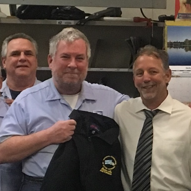 Chestnut Hill's Steve Clifford receives a Branch #34 jacket on his last day following more than 32 years.
