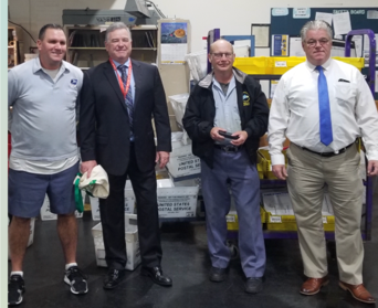 President Jerry McCarthy and  Manager Mike King congratulate Cambridge Retirees Dave Mahoney and John Tierney