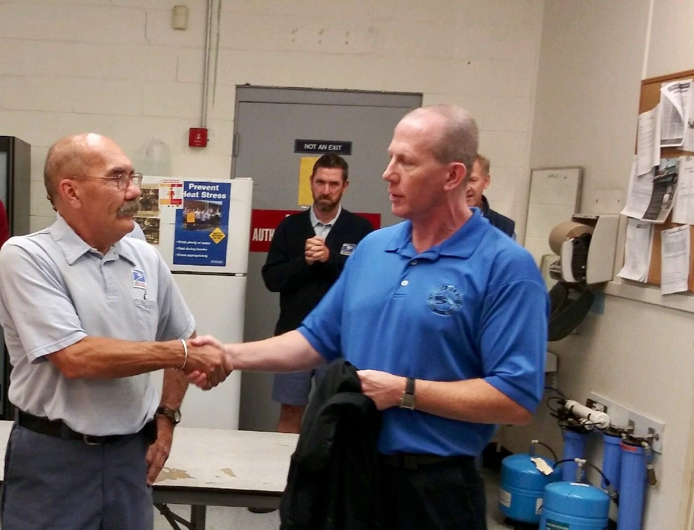 Branch Secretary-Treasurer Mike Murray congratulate Dorchester's Brian Morrissey on his more than 30 years of service.