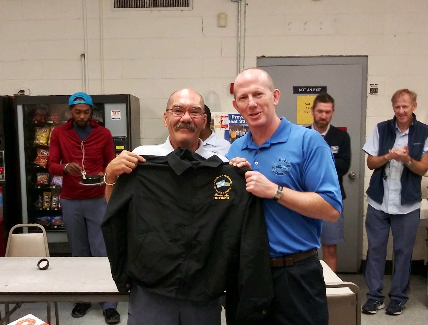 Secretary-Treasurer Mike Murray presents Dorchester's Brian Morrissey with a Branch #34 Jacket.