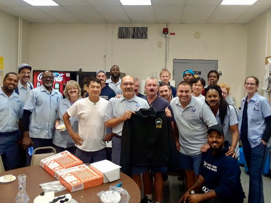 Dorchester Center Members join Mike Murray in saying goodbye to Brian Morrissey on his last day.