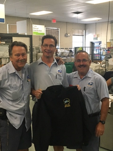 Mike Pierce and Mark Catinella congratulate Vic Dapsys (center) on his last day.