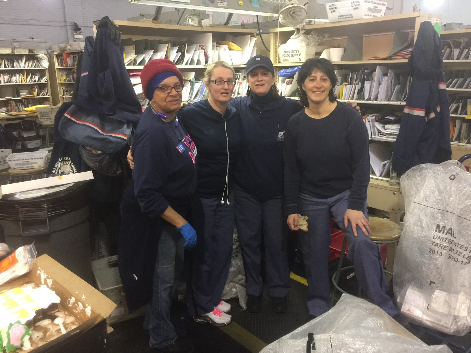 Newly Retired Brookline Member Eleanor Walsh (2nd from Right) with APWU Steward Wanda Jackson, FTR Carrier Kristen O'Connor and NALC Steward Maria Constantino
