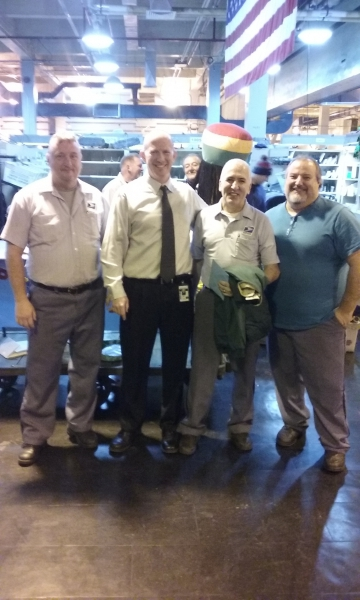Neil Guarino with Secretary Treasurer Michael Murray flanked by Fort Point Stewards Thor Hellested and Benny Faletra.