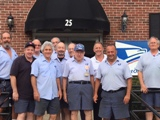 Newly retired Member Scott Hanley poses with his Weston coworkers.