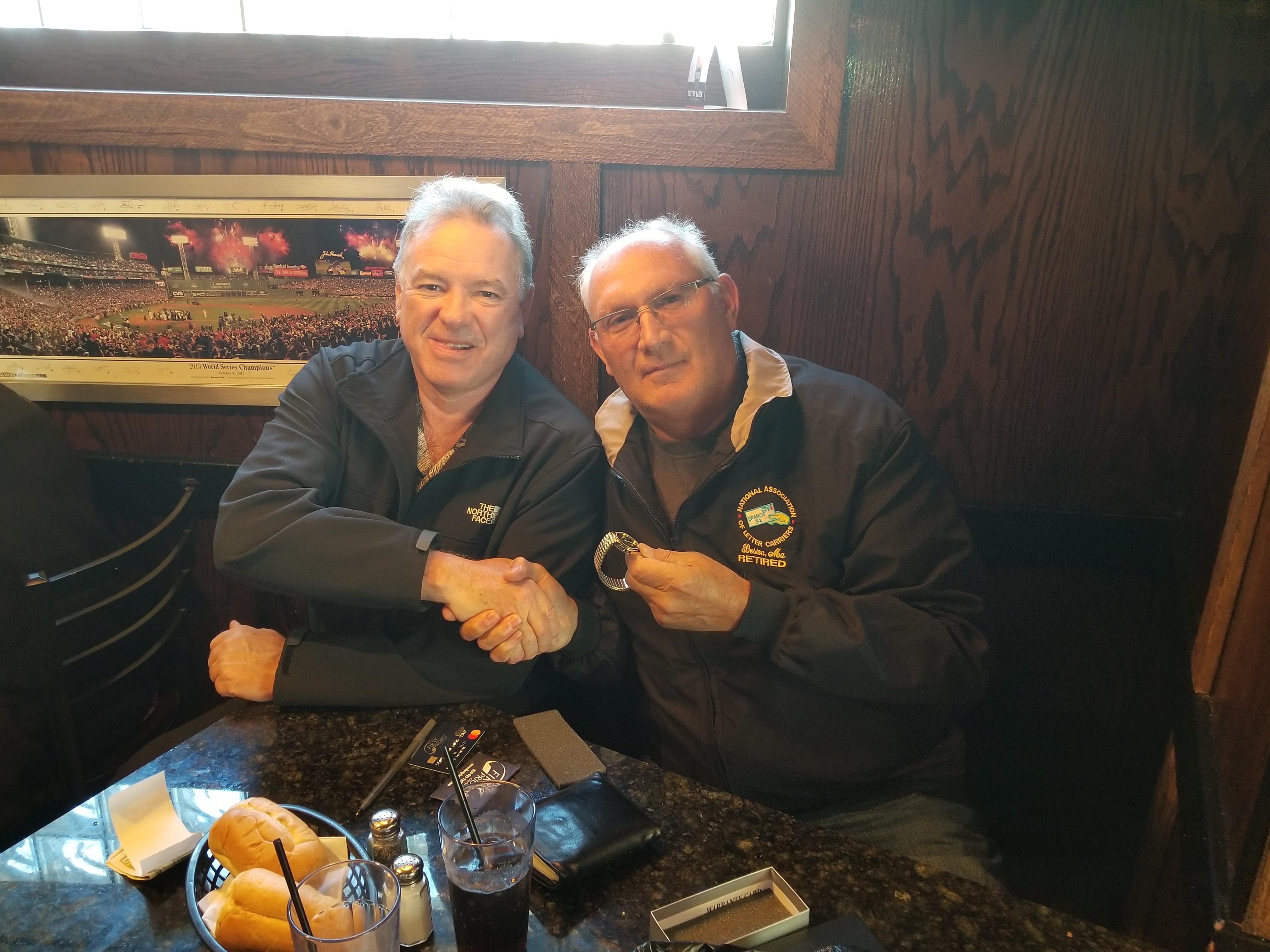 IMC Retiree Joe Dulcetta is congratulated by President Jerry McCarthy