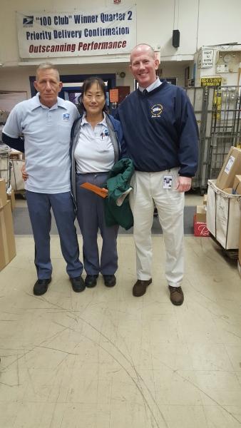 Wellesley Steward Tom Ryan and Secretary Treasurer Michael Murray congratulate Li Hsia Chin on her well deserved retirement