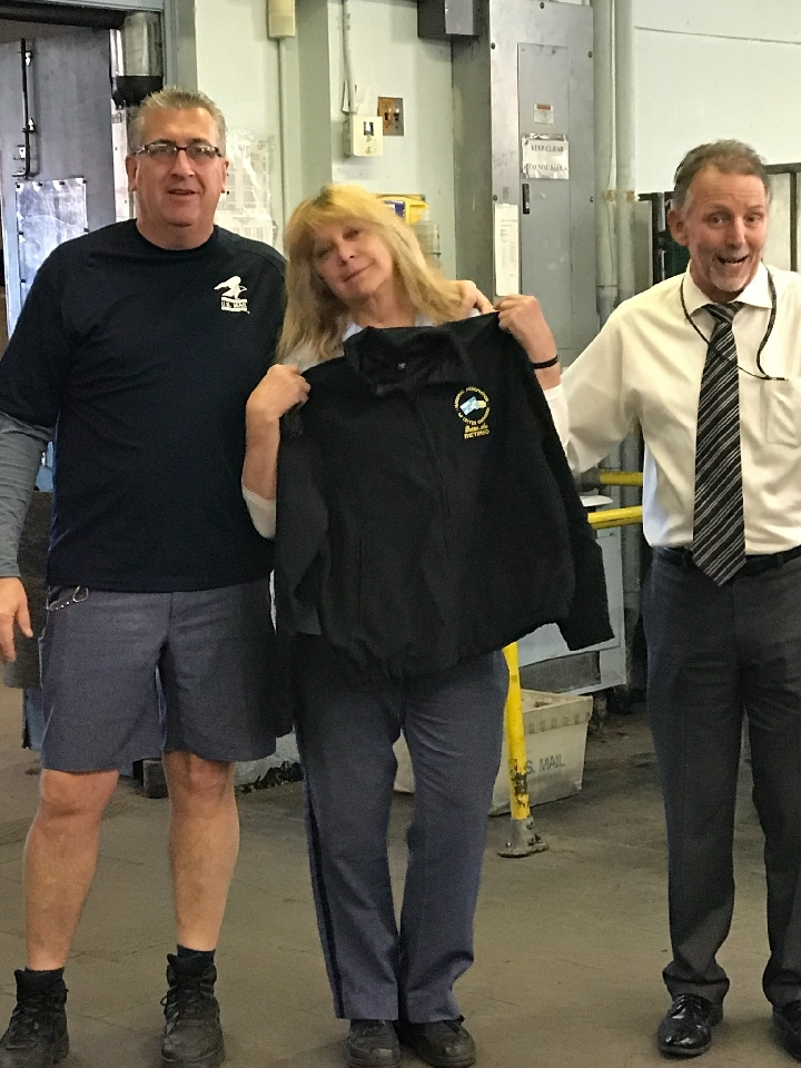 Branch #34 President Mike Yerkes and Medford Steward Steve White pose with newly retired Medford Member Elaine Vieno on her last day.