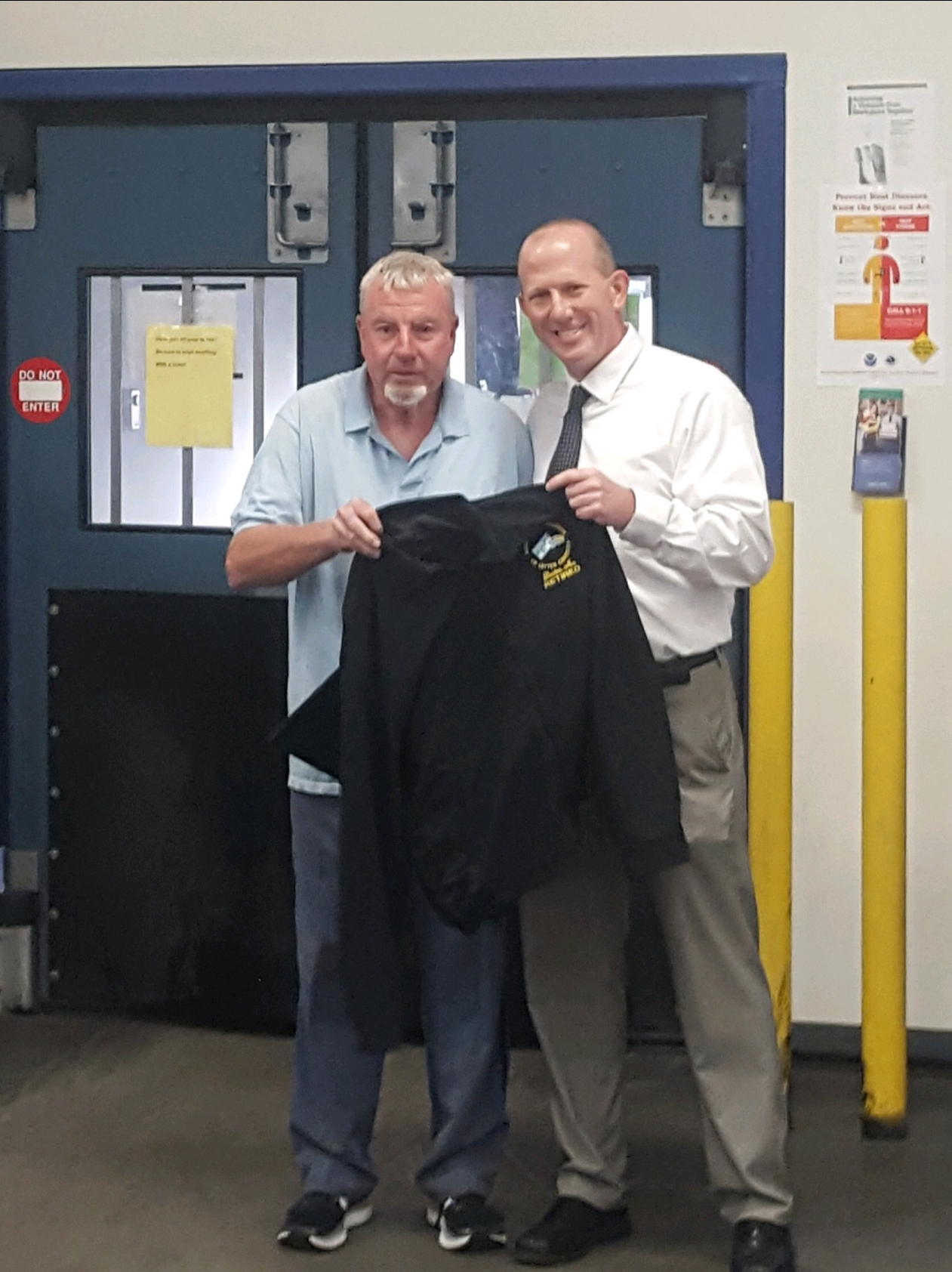 Branch Secretary Treasurer Mike Murray congratulates Melrose Member Mike O'Brien on his last day following more than 30-years of service.