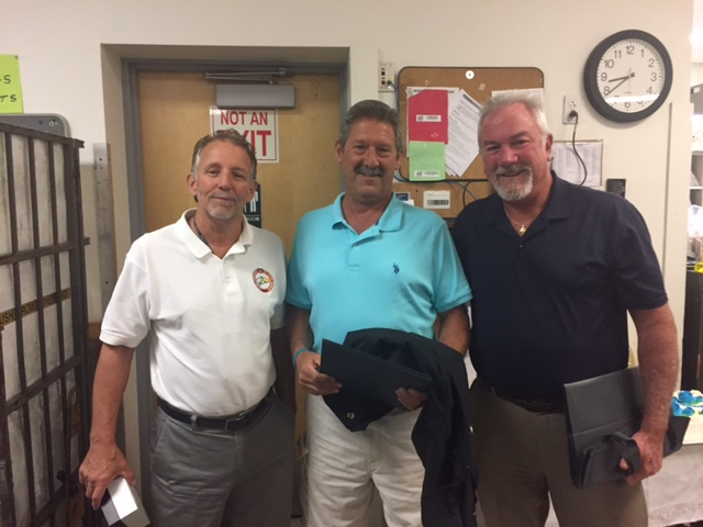 Mike Yerkes and Branch #34 Executive VP Kevin Flaherty pose with twenty plus year Steward Sal Ledda on his retirement.
