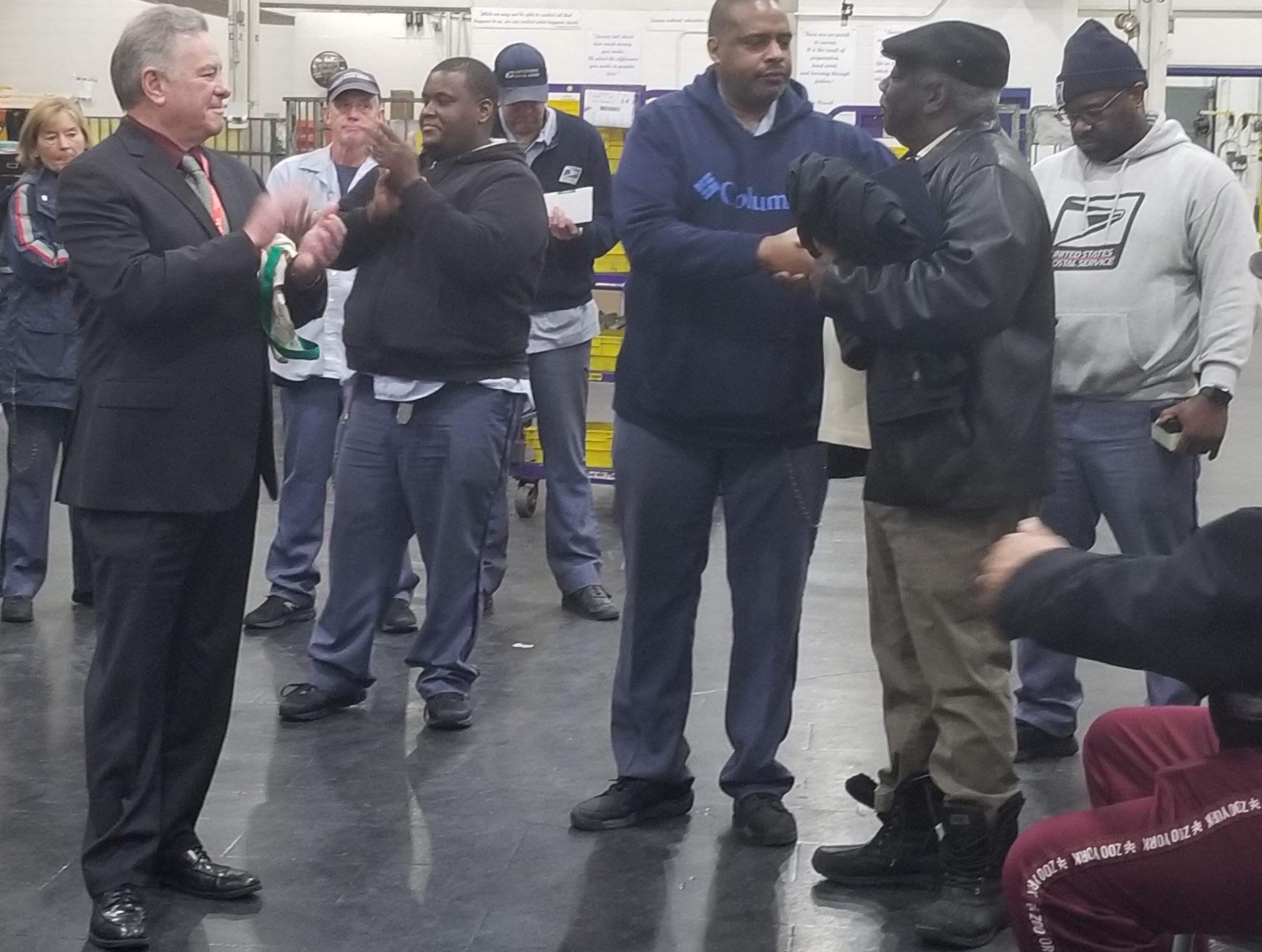 Shop-Steward-Keith-Meredith-Roxbury-Retiree-Bernard-Washington-along-with-President-Jerry-McCarthy-Copy-2