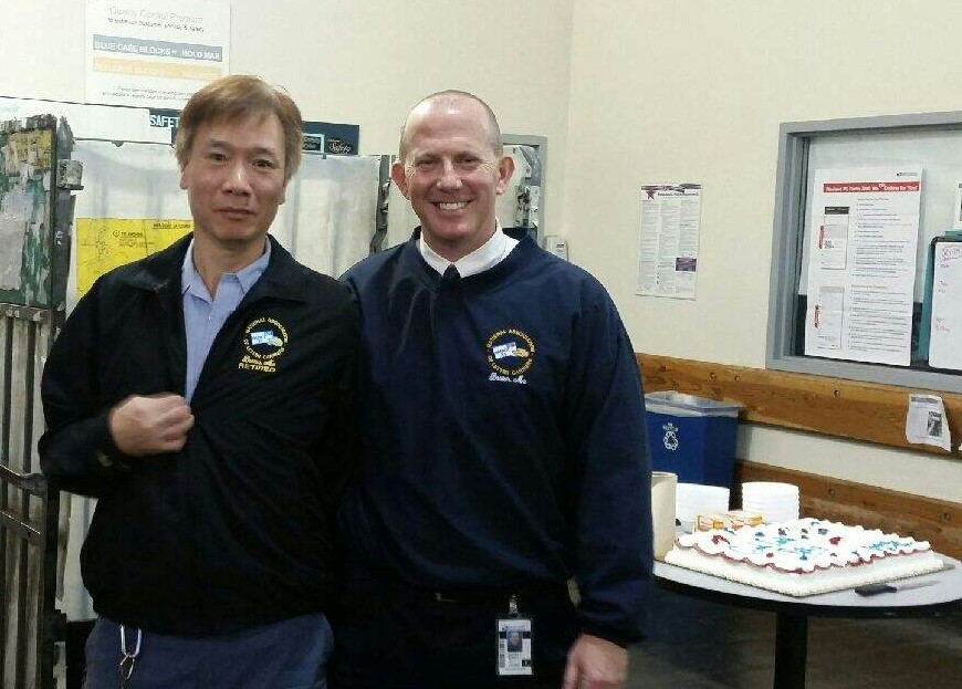 Branch Secretary Treasurer Mike Murray presented Brother Ricky Tam with retirement jacket on his last day.