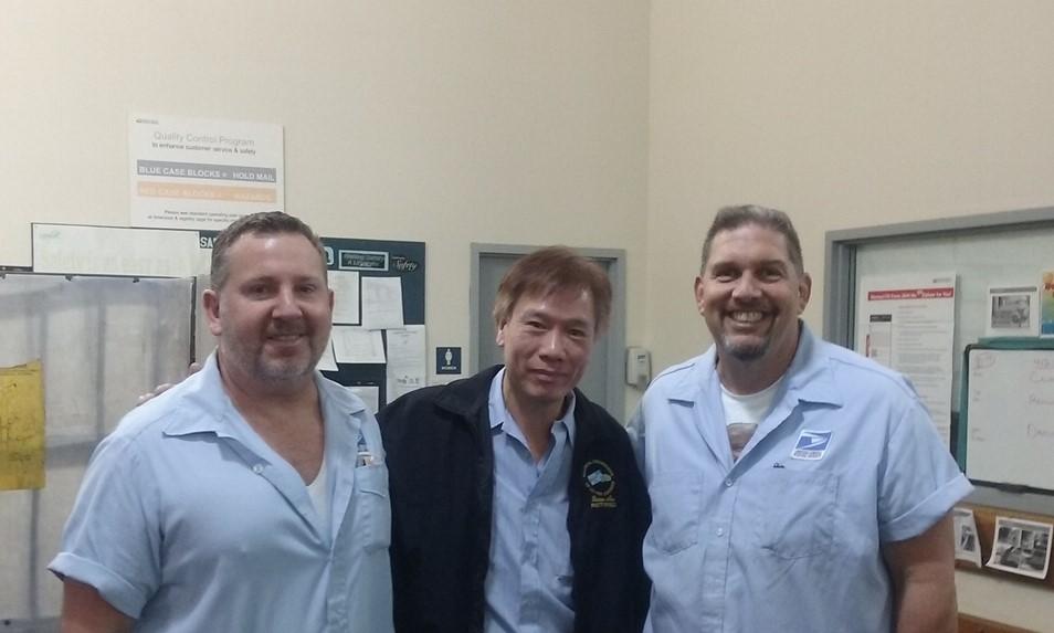 Ricky Tam congratulated by Bob Tremarche (R) and Central Square Steward Bill Wilkins.