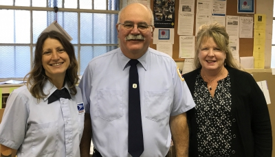Wellesley Sq. Retiree Kevin Leach is congratulated by Union Steward Toni Alexander & Vice President Bernadette Romans