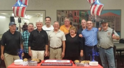 Co-workers congratulate Tom Dunn on his retirement