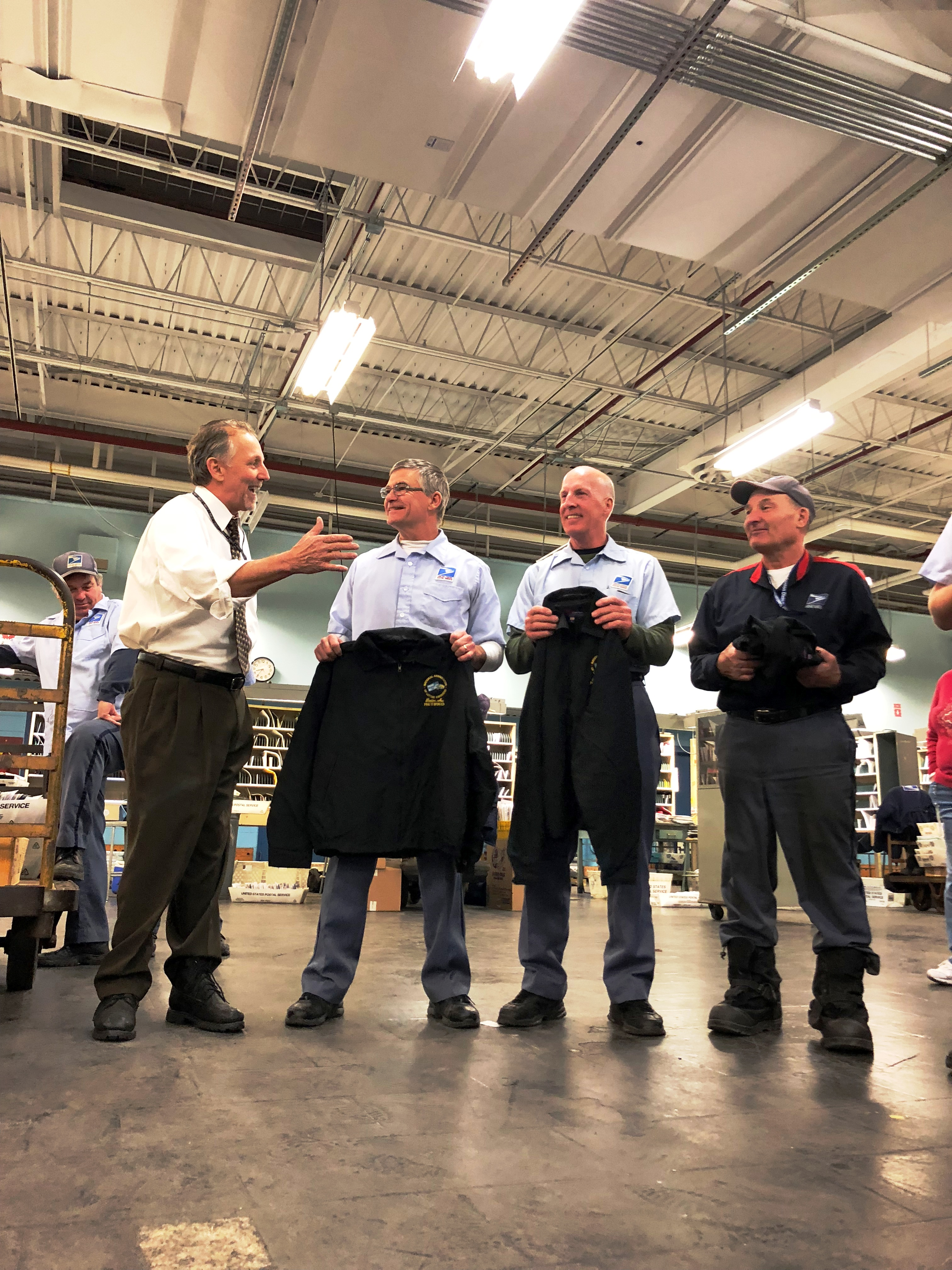 Branch President Mike Yerkes present jackets to Woburn's Big Three, Bill Shea, Tom Hoctor and Bob Cusolito on their last day of service.