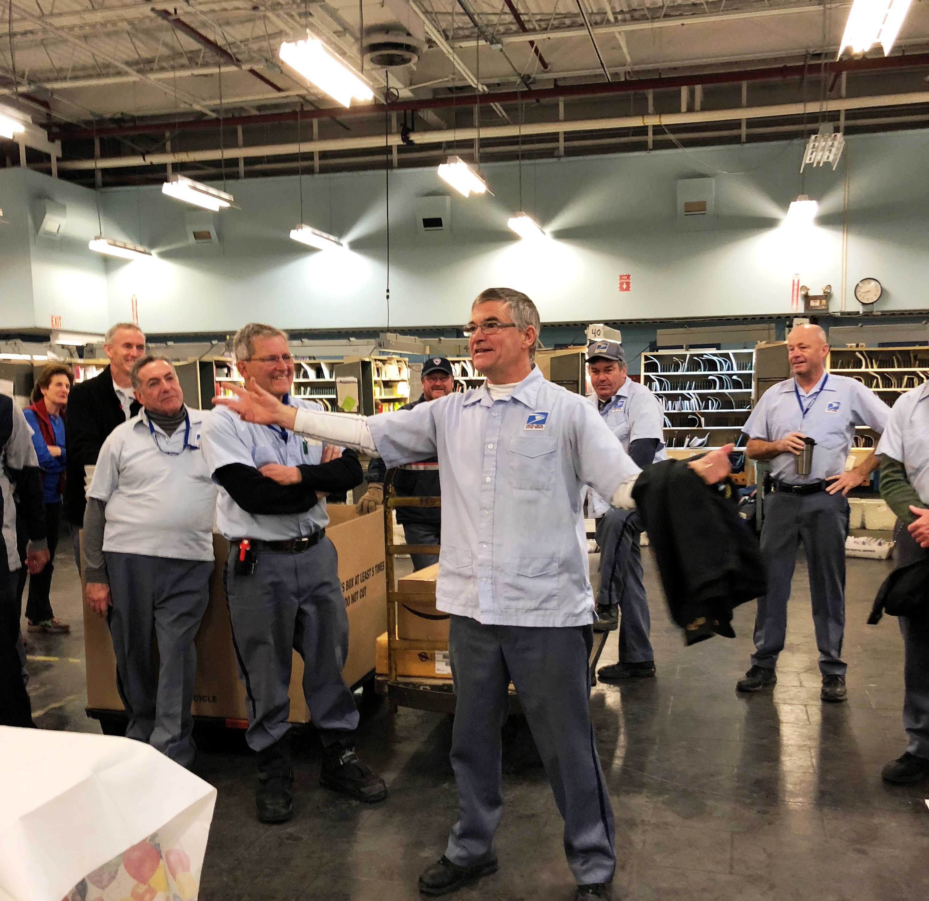 Bill Shea regales his Woburn coworkers with tales of yesteryear.