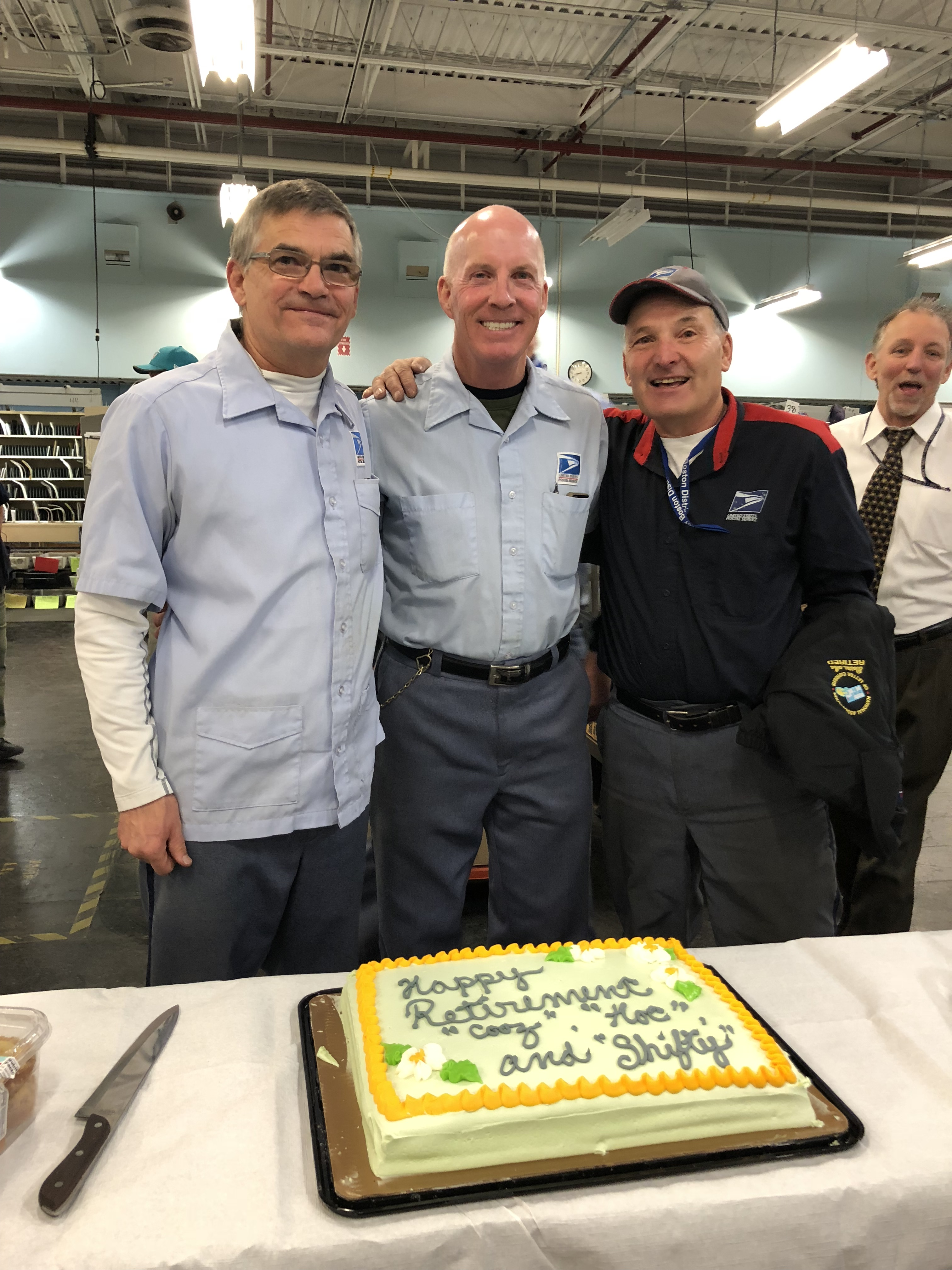 Bill Shea, Tom Hoctor and Bob Cusolito pose with their retirement cake.