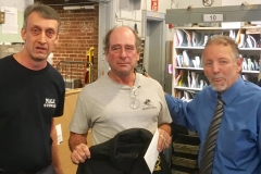 Milton Steward Bob Leighton and President Yerkes pose with 38-year Member Joe Wholey on his last day.
