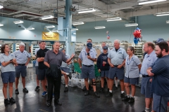 Woburn Members listen to Branch President Michael Yerkes as they say goodbye to retiring 30-Year Letter Carrier Jane Garchinsky (3rd from Right)